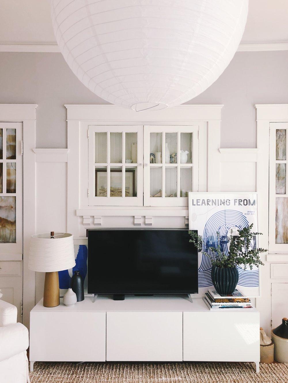 Cabinet: IKEA, lamp: vintage Martz lamp ( similar ), small white vase:  CB2 , black vase: vintage, Japan poster:  Design Museum Danmark , blue pot: Anthropologie