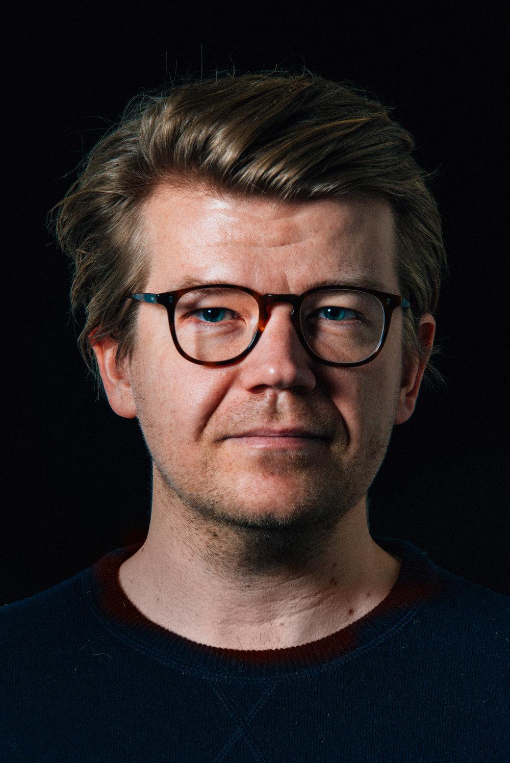 Jussi Mäkinen Head of marketing Black and white profile picture JPG version
