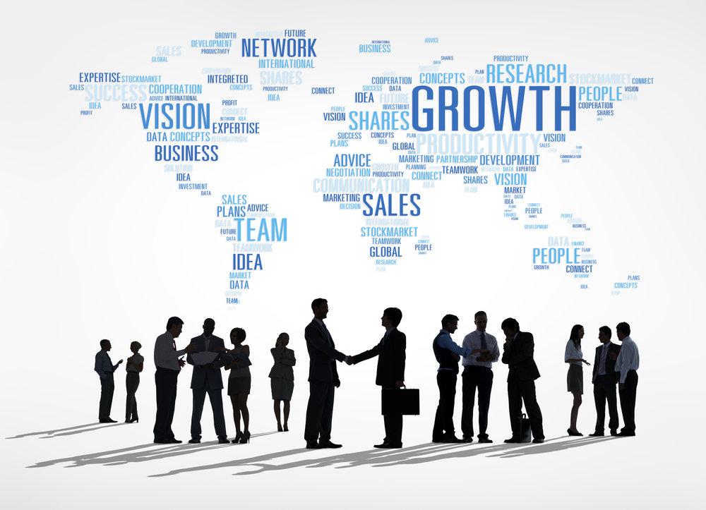 Business-people-under-atlas-made-of-business-words-000026342812_Full.jpg