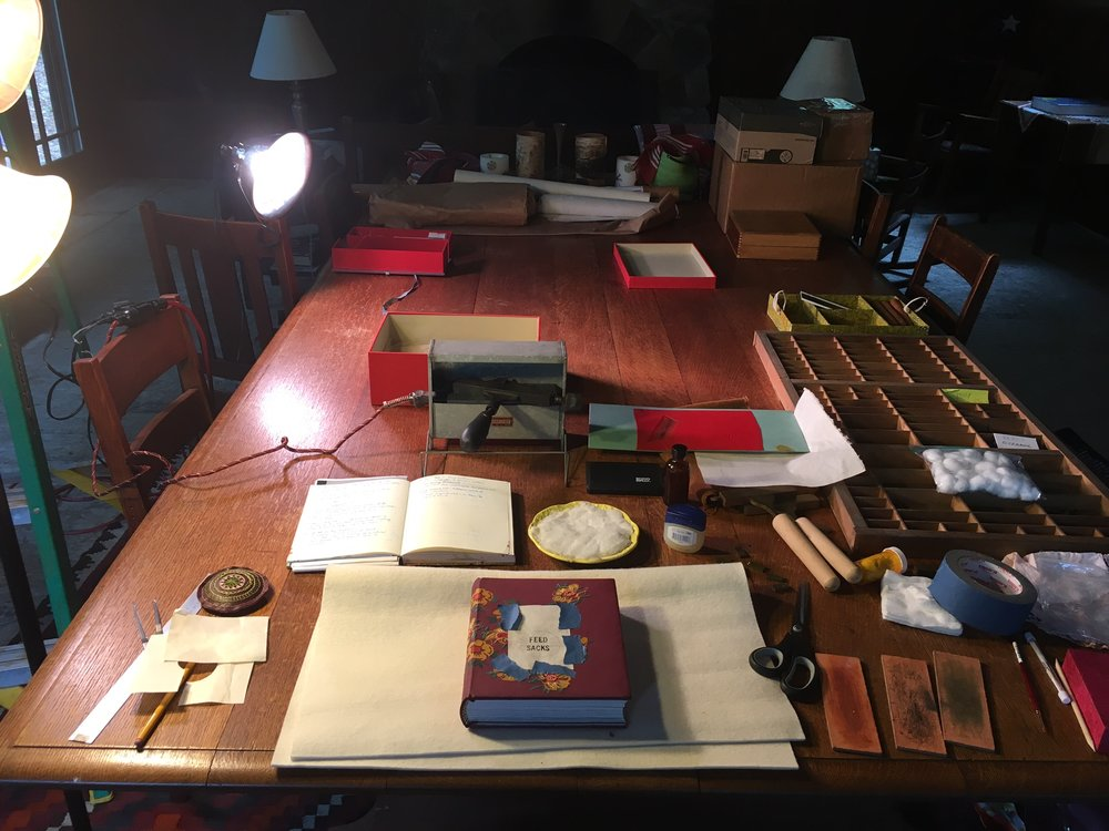 My tooling set up: tissue for creating the layout, my tooling notes from school, a cotton pad for cooling of my tool, a sweet french stove that Todd lent me, fixor, type, suede pads for cleaning of the tools, and my book.