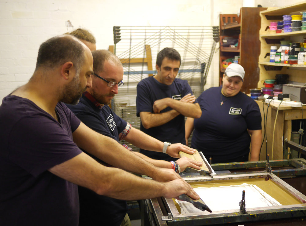 Left to right: David from Sheffield Print Club showing James, Hugo and Danielle the ropes.