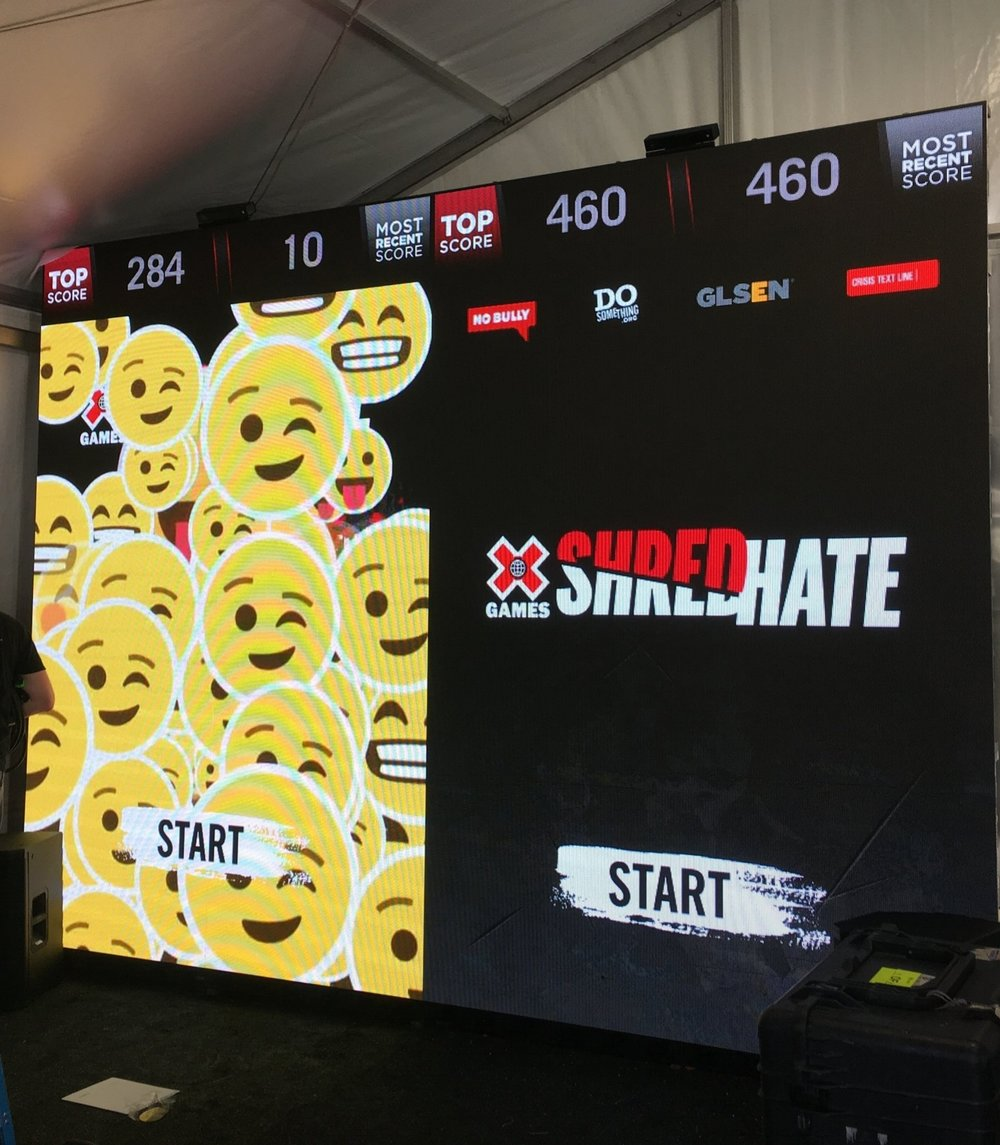 The Solution - Using a 120-foot screen, we developed a larger-than-life interactive video game where visitors could Shred Hate by using their body to shred life-sized negative words and phrases similar to the popular Fruit Ninja video game. We also created a custom GIF booth and welcomed star athletes to sign autographs and share their own anti-bullying experiences.