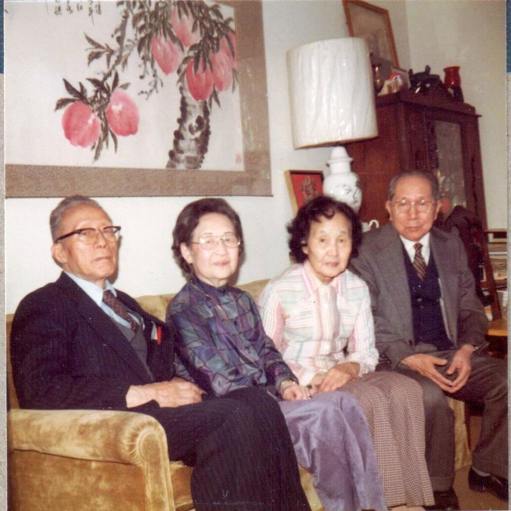 YH Ku and    ZZ Li    (CLass of 1922) . Pictured from left to right:  YH Ku, Mrs. Li  (nee SJ Fong) , Mrs. Ku  (nee Wei-Zing Wang)  and ZZ Li, Ku home, ca. 1977. The Ku family home became a gathering place for many MIT alumni and friends. Courtesy Lillian Li.