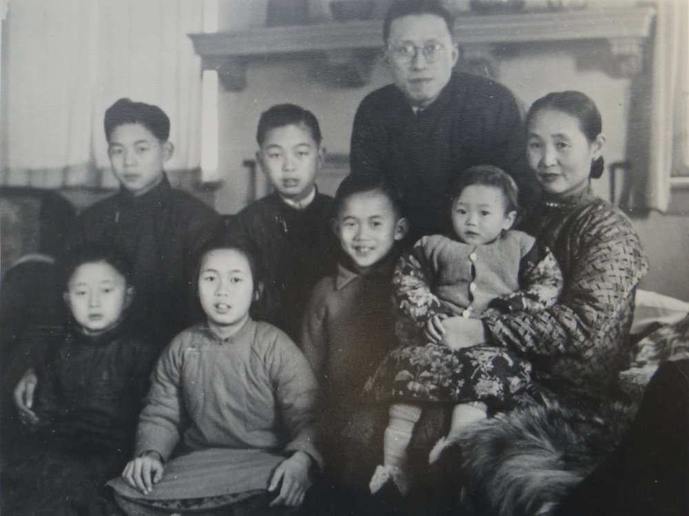 Ku family in Shanghai 1946. Back row left to right: #1 son Ku Wei-Lien, #2 son Ku Wei-Qing, Ku Yu-hsiu,  Mrs. Ku (Wang Wei-Zing ). Front row: #3 son Ku Wei-Hua (Walter), #1 daughter (3rd child) Ku Wei-Wen, #4 son Ku Wei-chung (John), #2 daughter Ku Wei-Ming (Anna). Not shown: #5 son Ku Wei-Kuo (Victor).  Courtesy Anna Ku Lau.