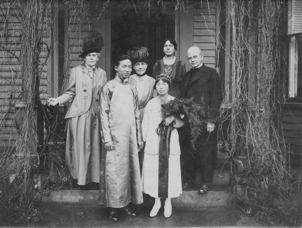 Wedding picture of Yang-Mo Kuo and Wai-Tsu New in 1918. Left to right in the back: Mary R. Cabot, Grace Cabot Holbrook, Grace Ware Holbrook Haskell, Reverend W Dewees Roberts. Courtesy of Veronica Haskell (granddaughter in law of Grace Haskell).