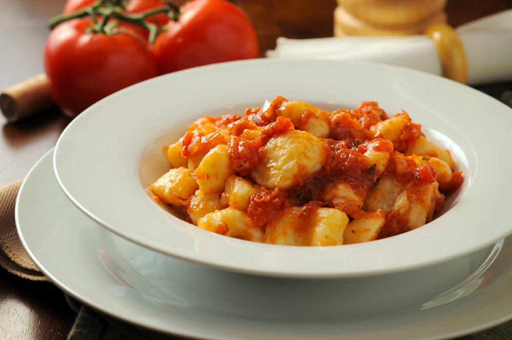 Traditional potato gnocchi finished in a light red sauce. Photo credit: Jason Poole @ http://analogjeans.com/