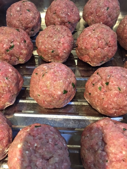 rolled raw meatballs.JPG