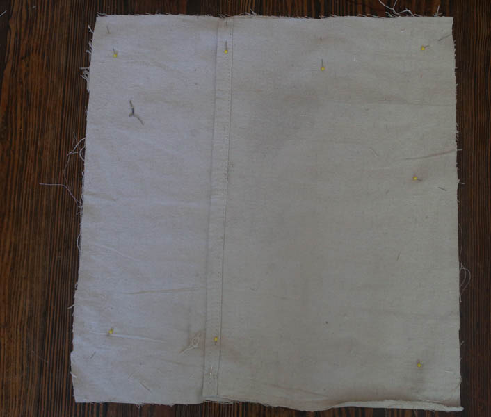how to make a farmhouse style pillow cover with drop cloth