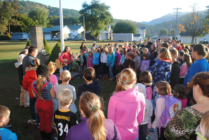"""Sophomore Kara Smith plays """"Amazing Grace"""" during See You at the Pole"""