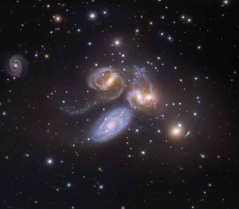 intergalactic-3rdeyevisions :      just–space :     Stephans Quintet - Four of these five galaxies are locked in a cosmic dance of repeated close encounters taking place some 300 million light-years away.    js