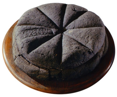 "lordhayati :        drtanner :      dancingspirals :      ironychan :      hungrylikethewolfie :      dduane :      wine-loving-vagabond :     A loaf of bread made in the first century AD, which was discovered at Pompeii, preserved for centuries in the volcanic ashes of Mount Vesuvius. The markings visible on the top are made from a Roman bread stamp, which bakeries were required to use in order to mark the source of the loaves, and to prevent fraud. (via  Ridiculously Interesting )     (sigh) I've seen these before, but this one's particularly beautiful.     I feel like I'm supposed to be marveling over the fact that this is  a loaf of bread  that's been preserved for thousands of years, and don't get me wrong, that's hella cool.  But honestly, I'm mostly struck by the unexpected news that ""bread fraud"" was apparently once a serious concern.     Bread Fraud was a huge thing,  Bread was provided to the Roman people by the government - bakers were given grain to make the free bread, but some of them stole the government grain to use in other baked goods and would add various substitutes, like sawdust or even worse things, to the bread instead.  So if people complained that their free bread was not proper bread, the stamp told them exactly whose bakery they ought to burn down.     Bread stamps continued to be used at  least  until the Medieval period in Europe. Any commercially sold bread had to be stamped with an official seal to identify the baker to show that it complied with all rules and regulations about size, price, and quality. This way, rotten or undersized loaves could be traced back to the baker. Bakers could be pilloried, sent down the streets in a hurdle cart with the offending loaf tied around their neck, fined, or forbidden to engage in baking commercially ever again in that city. There are records of a baker in London being sent on a hurdle cart because he used an iron rod to increase the weight of his loaves, and another who wrapped rotten dough with fresh who was pilloried. Any baker hurdled three times had to move to a new city if they wanted to continue baking.      If you have made bread, you are probably familiar with a molding board. It's a flat board used to shape the bread. Clever fraudsters came up with a molding board that had a little hole drilled into it that wasn't easily noticed. A customer would buy his dough by weight, and then the baker would force some of that dough through the hole, so they could sell and underweight loaf and use the stolen dough to bake new loafs to sell. Molding boards ended up being banned in London after nine different bakers were caught doing this.  There were also instances of grain sellers withholding grain to create an artificial scarcity drive up the price of that, and things like bread.     Bread, being one of the  main things  that literally everyone ate in many parts of the world, ended up with a plethora of rules and regulations. Bakers were probably no more likely to commit fraud than anyone else, but there were  so many  of them, that we ended up with lots and lots of rules and records of people being shifty.     Check out  Fabulous Feasts: Medieval Cookery and Ceremony  by Madeleine Pelner Cosman for a whole chapter on food laws as they existed in about 1400. Plus the color plates are  fantastic .      Holy shit.     Bread is serious fucking business.        Man the bread fandom don't put up with shit at all."