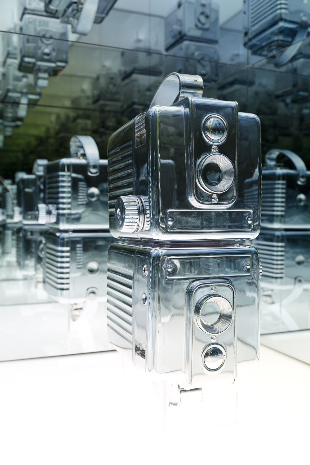 Andrew Wright,  Disused Twin Brownie Hawkeye Cameras , Silvered objects, custom plinth, 33 x 33 x 152cm, 2015