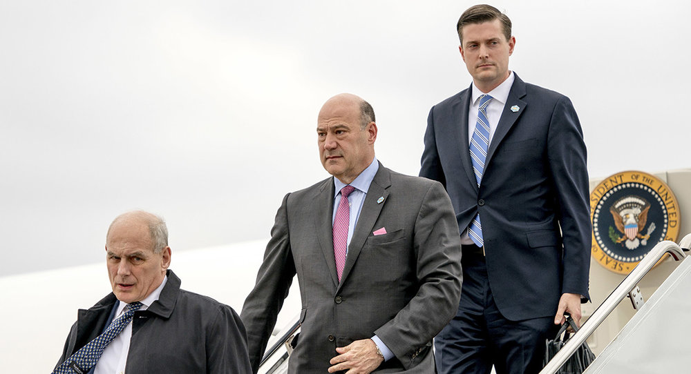 Gary Cohn and Rob Porter walking behind Chief of Staff, John Kelly.