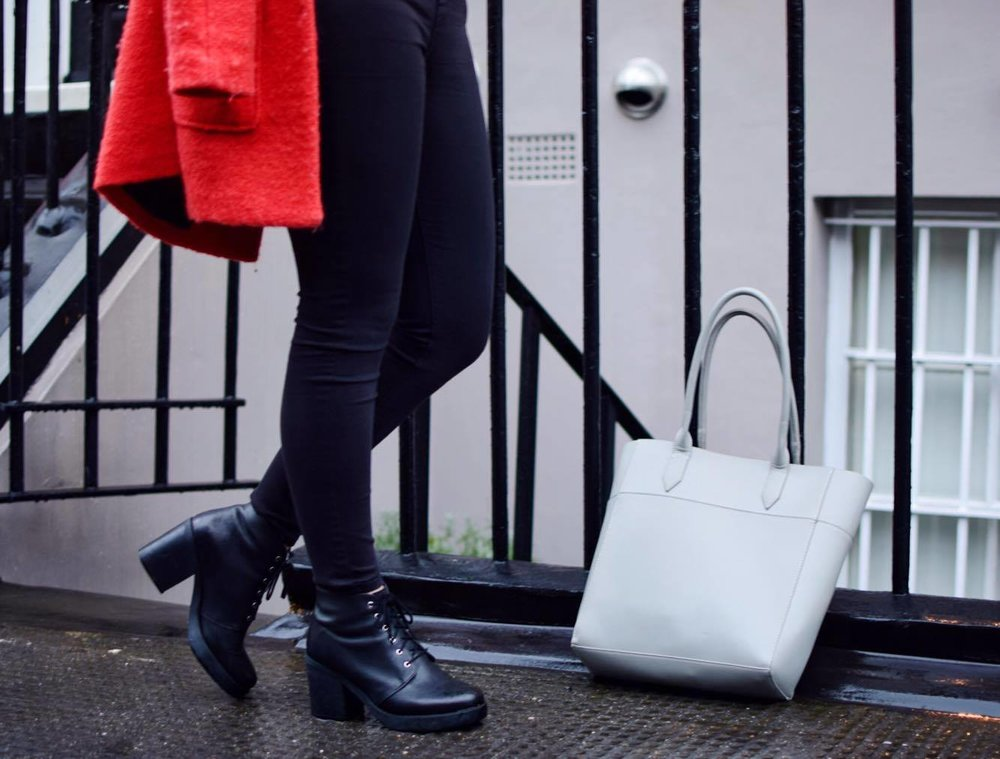 Rosemary wears Topshop black skinny jeans and ASOS boots and shopper.