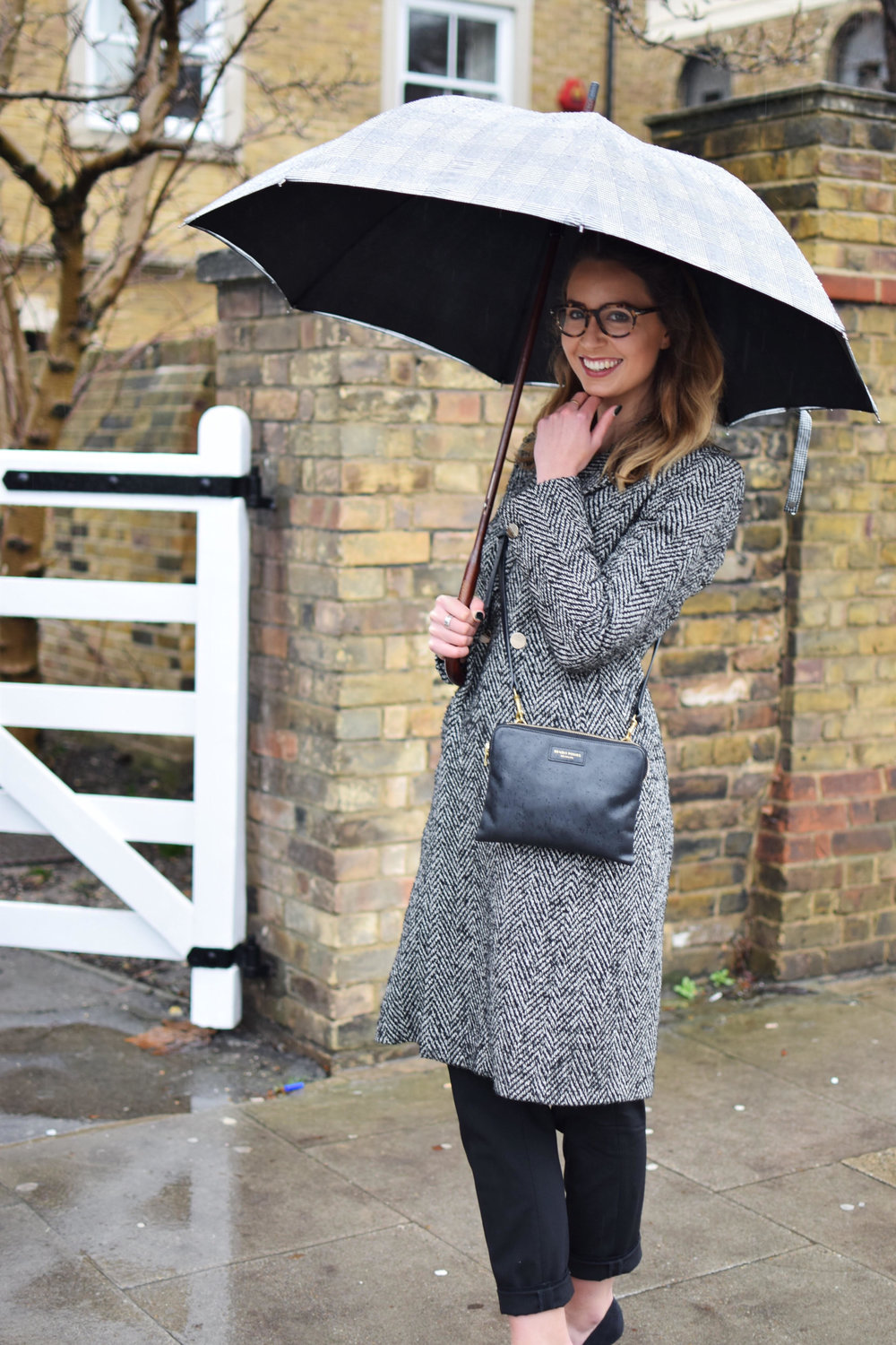 Looking sophisticated in rain or shine! Ted Baker jacket, Hobbs trousers, Deadly Ponies handbag, and London Undercover umbrella (all linked below).