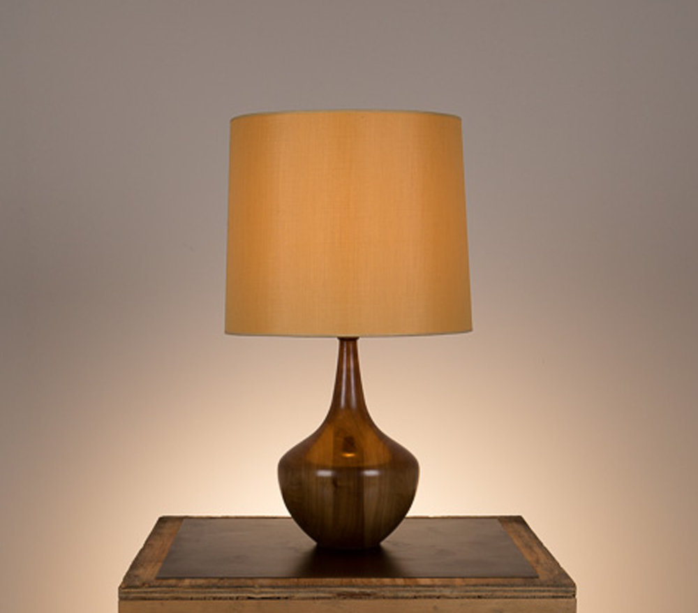 Bradley Table Lamp #1  Walnut in a medium brown finish. Semi-closed top lamp shade in gold silk.
