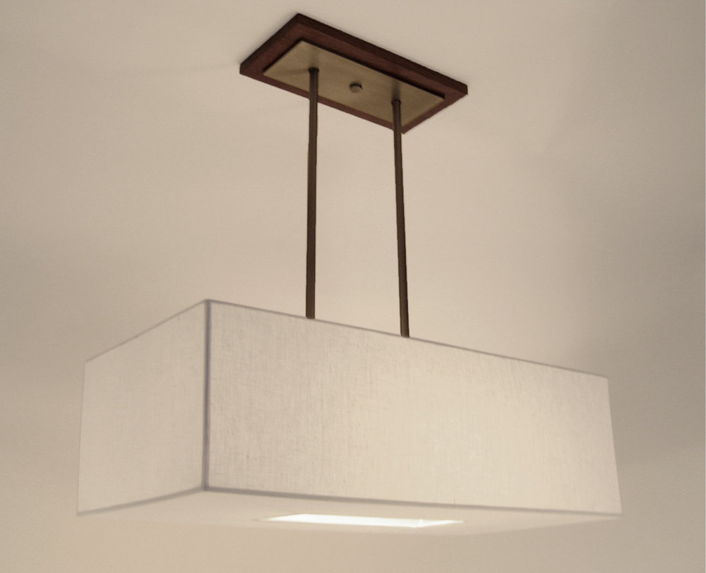 Diego Double Pendant  Medium walnut canopy with pewter fittings / white linen shade.