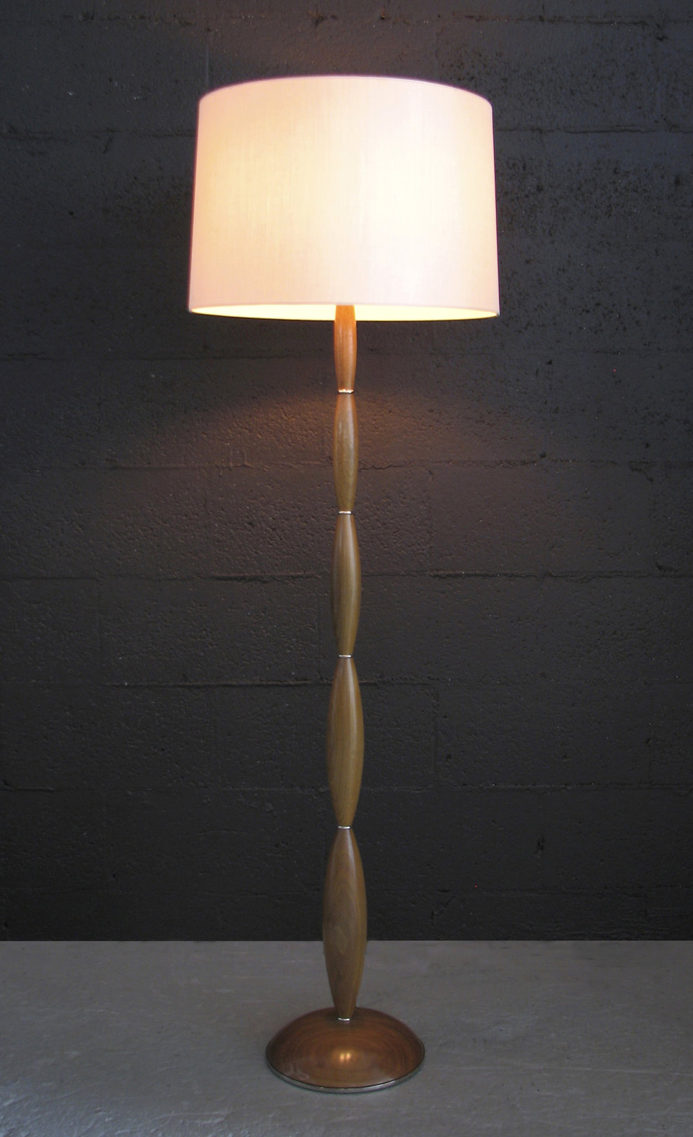 Alexis Floor Lamp  Raw Honey finish on Walnut with polished nickel fittings.  White Linen shade.