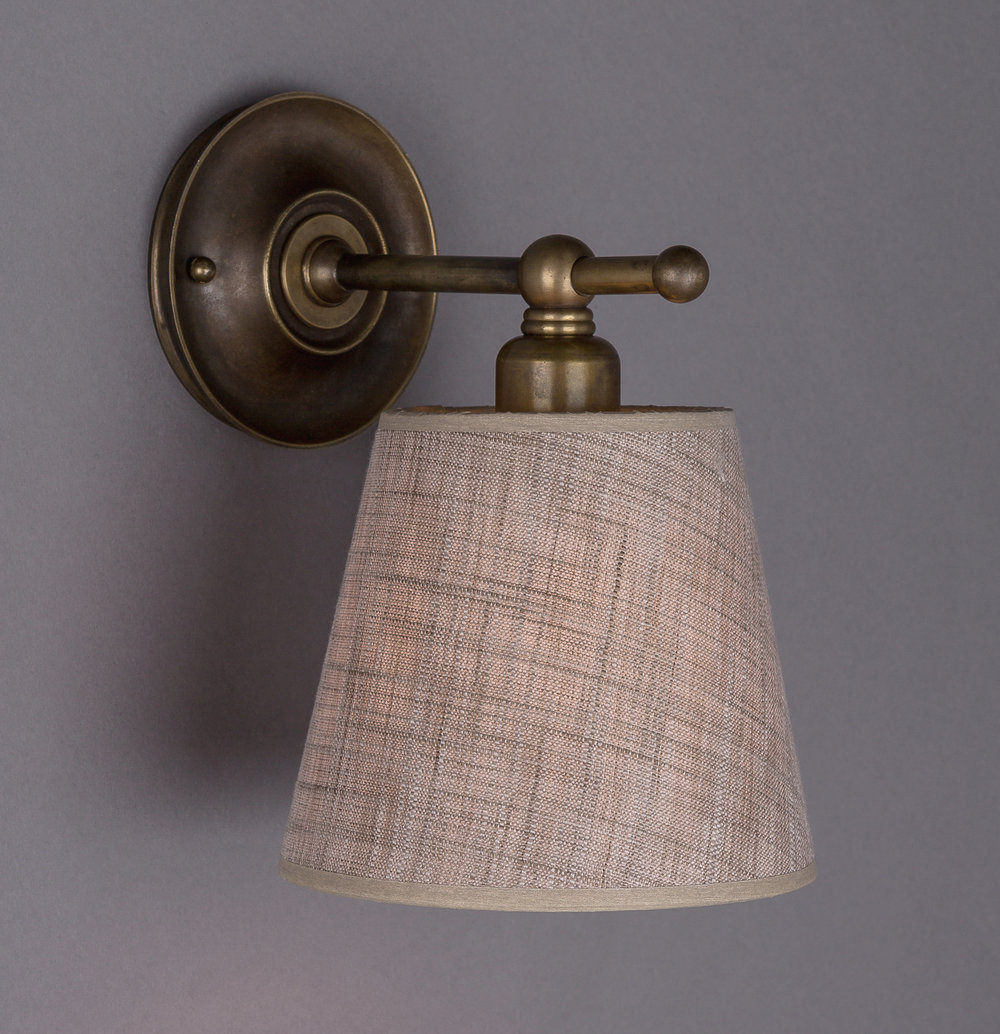 Inverted Dexter Sconce  Dark antique brass / 260 beige linen shade.