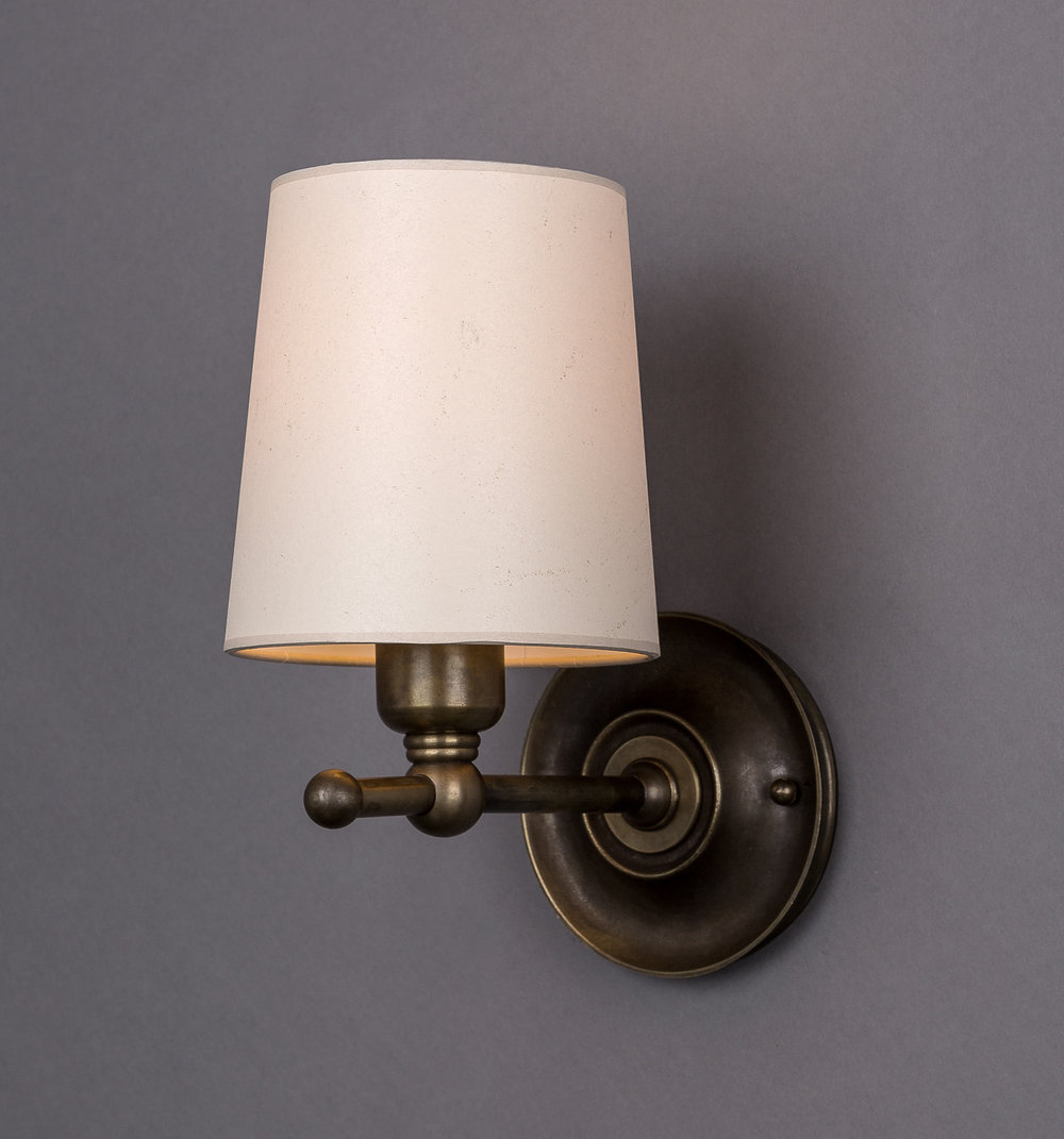 Dexter Sconce  Dark antique brass / parchment shade.