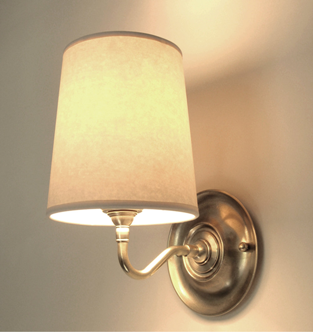 Jameson Sconce  Unlacquered hand polished brass / parchment shade.