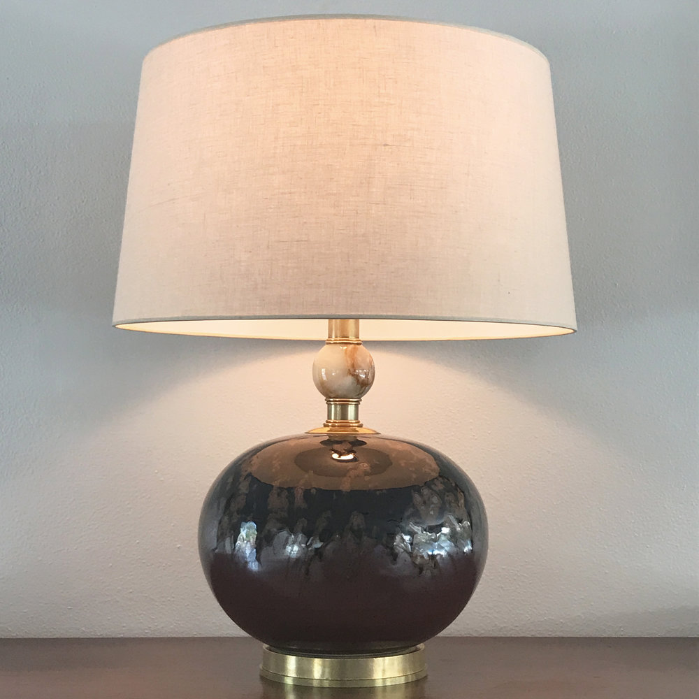 Ceramic & Onyx Table Lamp  Ceramic body and onyx ball with unlacquered brass base and fittings. Full range dimmer on socket with brown silk cord.  Shown with a beige linen shade.