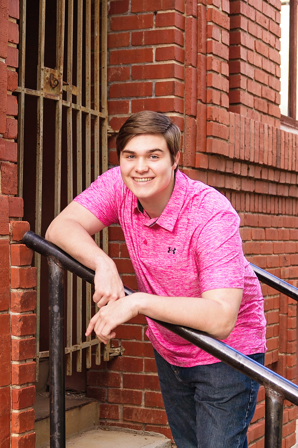guy in pink shirt on stairs.jpg