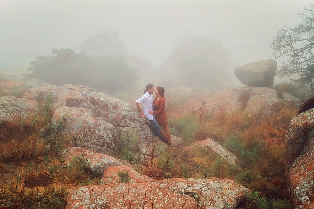 Couple in fall colors in the fog among rocks and foilage.jpg