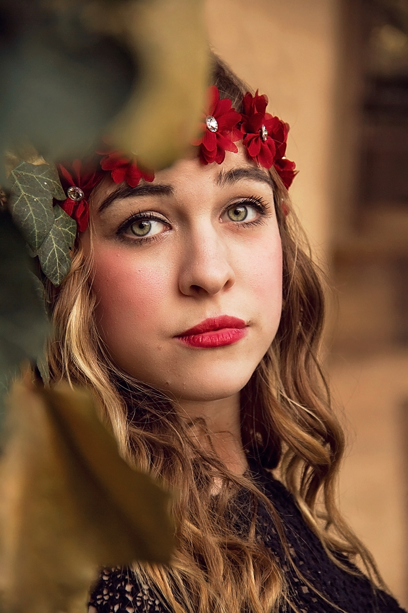 girl in floral crown amongst the leaves.jpg