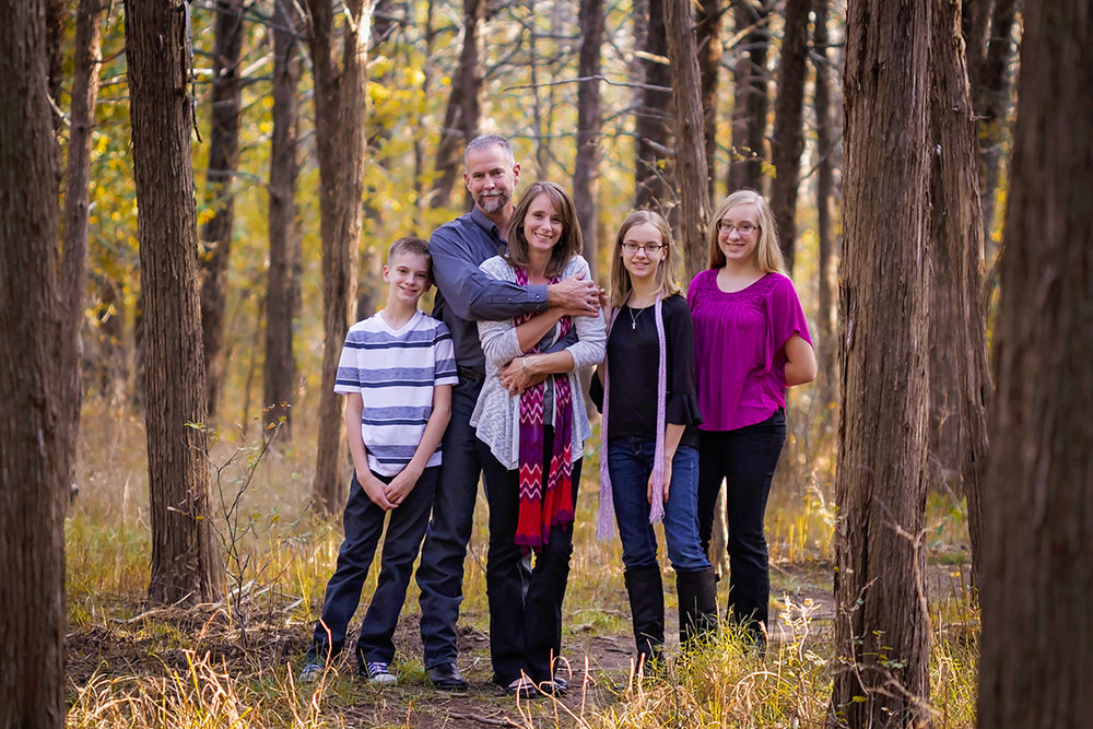Happy family of 5 in the woods.jpg