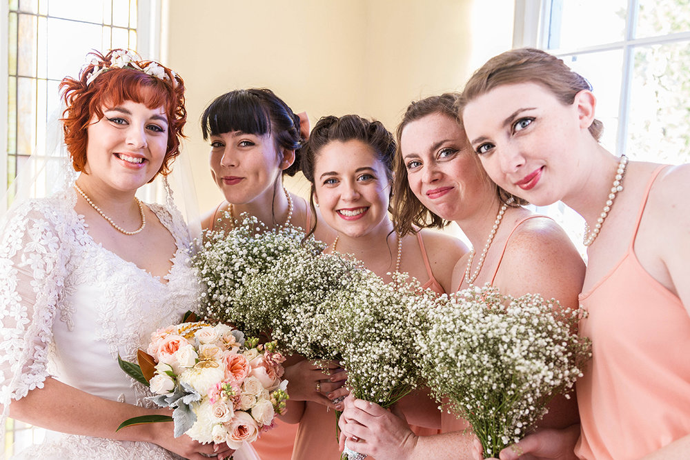 Vintage Bride and her beautiful bridesmaids holding bouquets.jpg