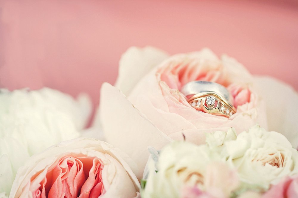 Vintage rings nestled amidst a floral bouquet.jpg
