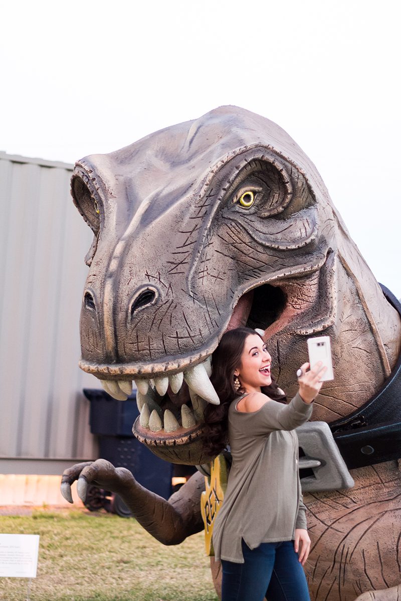 Senior Girl taking a Selfie with a TREX.jpg