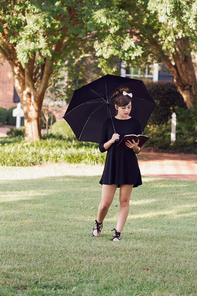 Audrey Hepburn styled session  girl reading book under umbrella.jpg