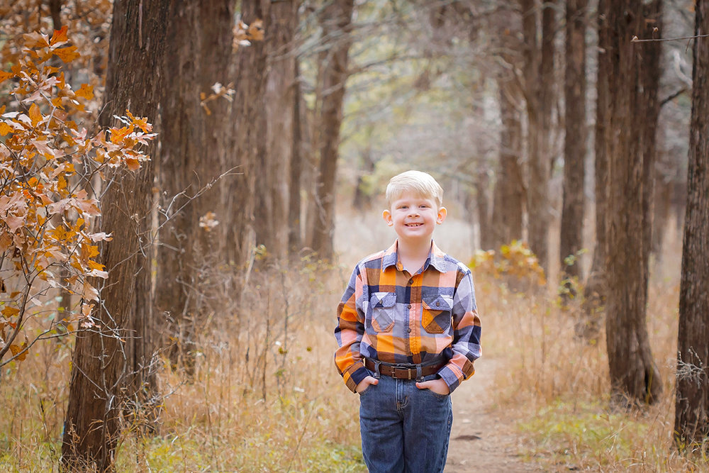 Little Boy in Plaid standing in forest.jpg