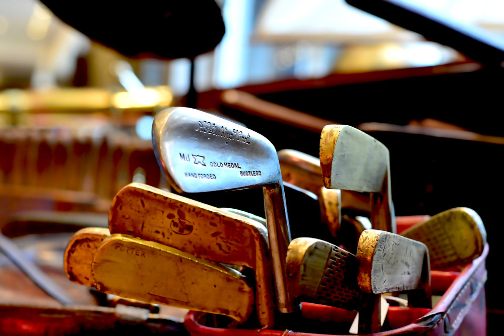 Golf clubs looking for a career change as glorified antiquities, Saint-Ouen, Paris