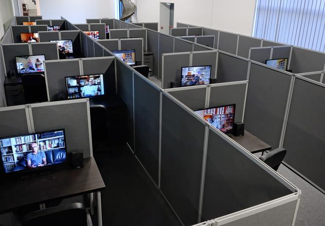 Kader Attia, Reason's Oxymorons, 2015, 18 films and installation of cubicles   duration: variable, 13 to 25 minutes.    Installation view, la Biennale de Lyon, 2015.    © Blaise ADILON; ADAGP, Paris 2015. Courtesy the artist, Lehmann Maupin, New York and Hong Kong, Galerie Nagel Draxler, Berlin, and la Biennale de Lyon.