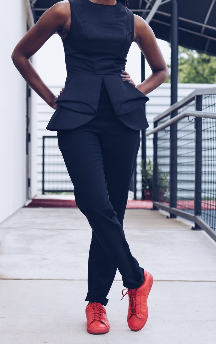 aqaq black peplum jumpsuit with red nike sneakers tennis shoes