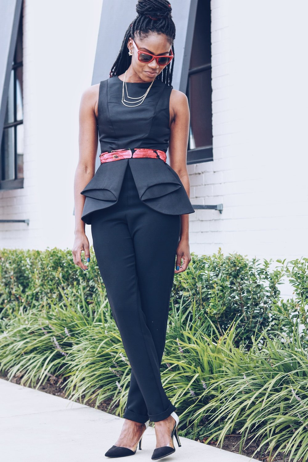 black jumpsuit by aqaq black and red belt black white gold pumps from heels to laces