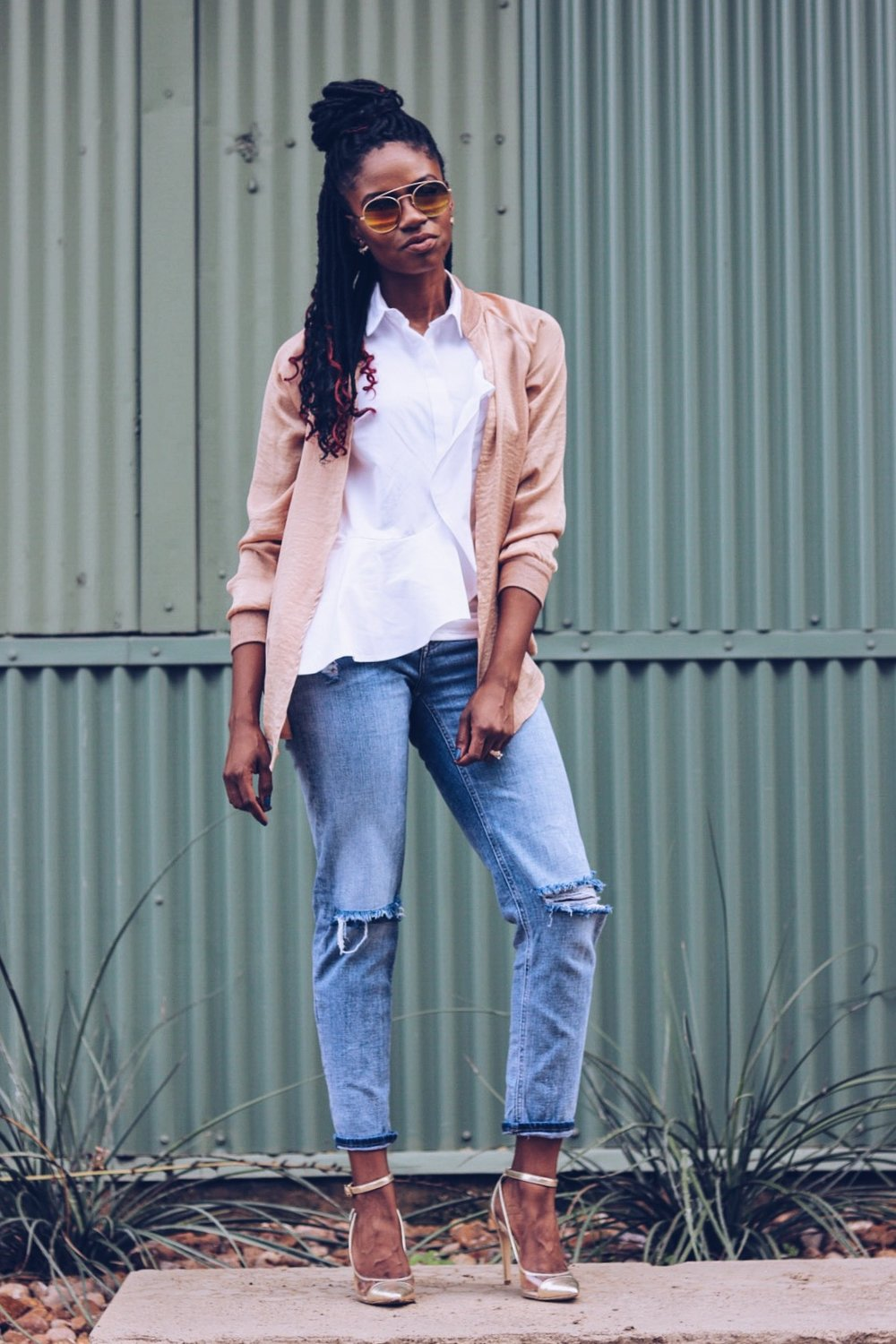 how to wear mixed metallics rose gold bomber distressed denim white ruffle top metallic gold and clear pump
