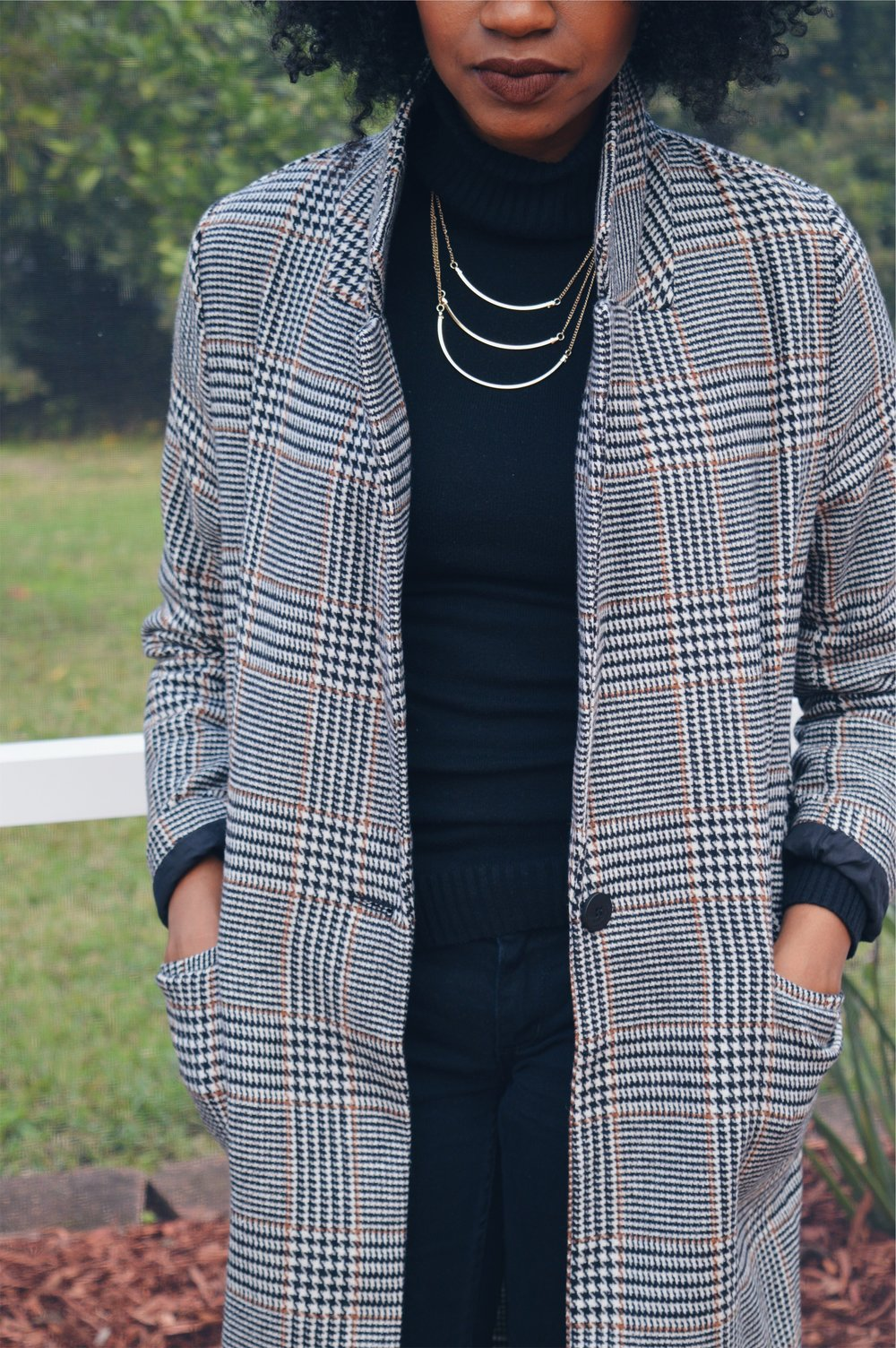 long plaid trench coat black turtleneck black distressed jeans wine booties