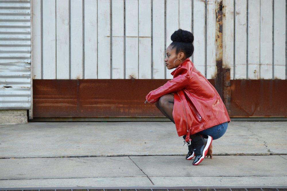 red patent leather moto jacket distressed mom jean shorts fishnet tights black v-neck jordan 11