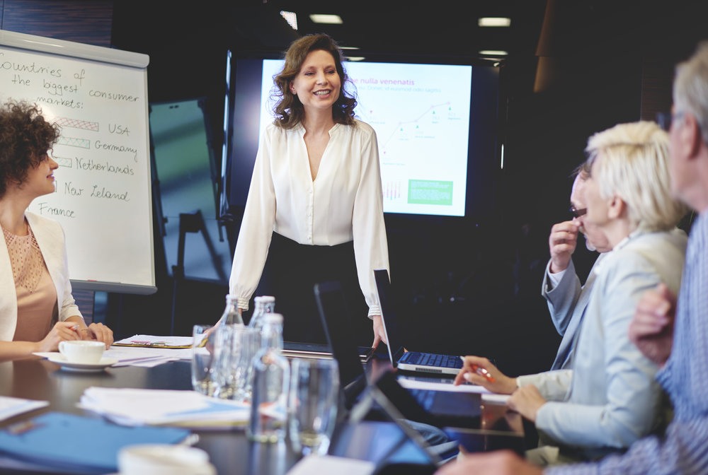 storyblocks-business-woman-in-conference-room-giving-speech_SwlYv5WK5G.jpg