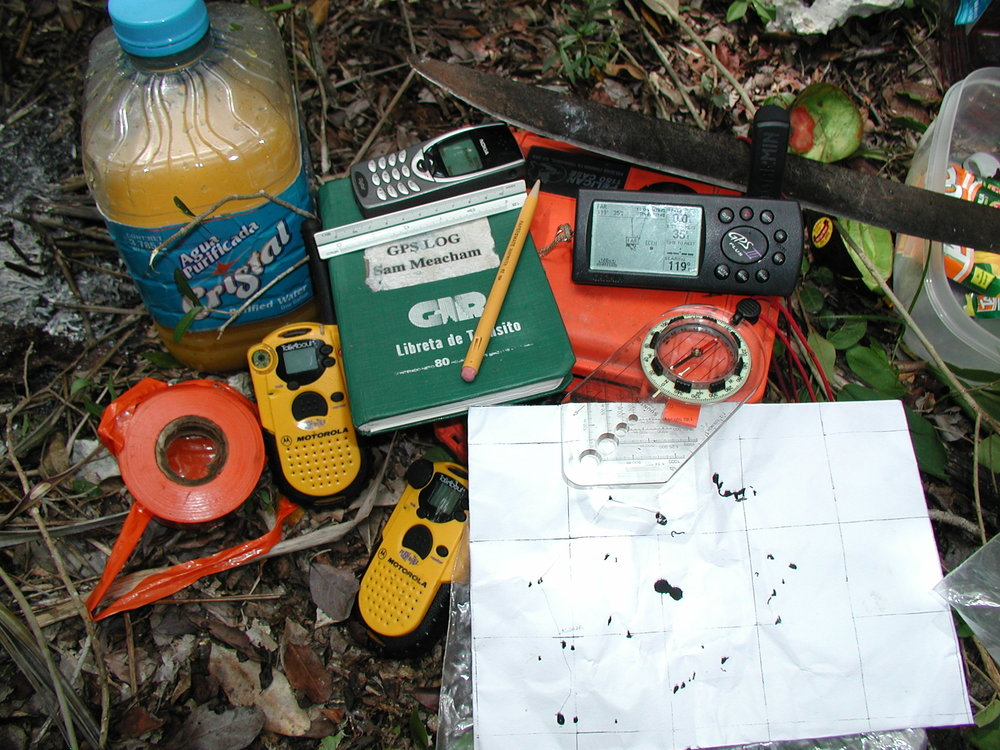 GPS, compass and a hybrid map made from topo maps and aerial photographs.