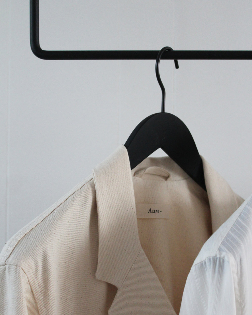 Painters jacket on clothing rack designed by Anneleena Leino.