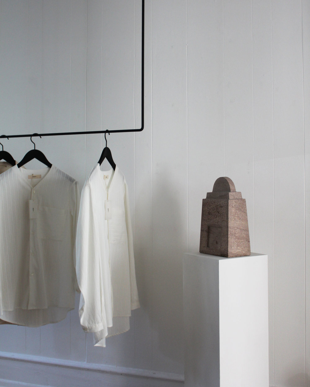 Constantin shirts and stone sculpture by Sys Vinding.