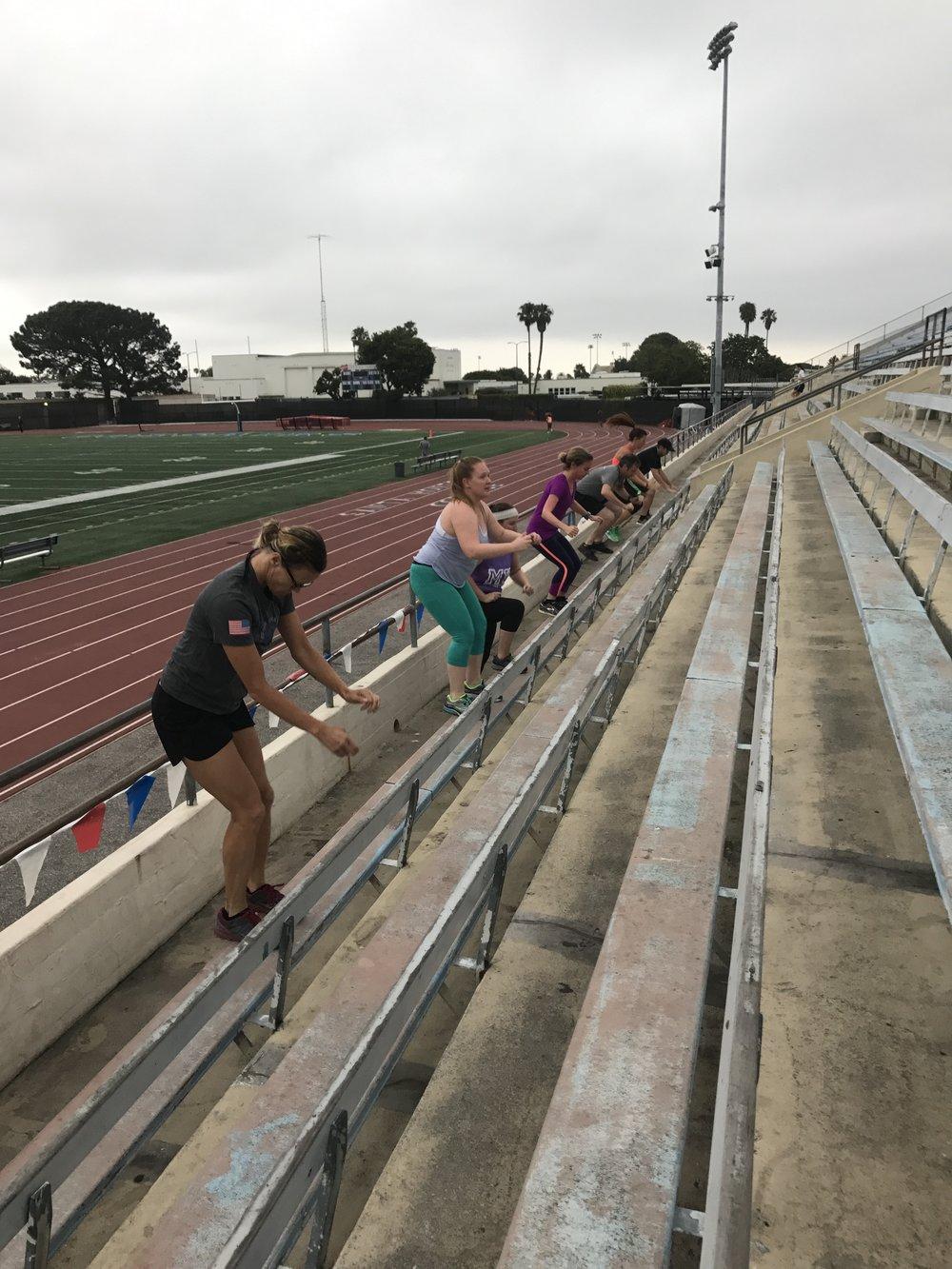 Track Tuesdays bleacher jumps.JPG