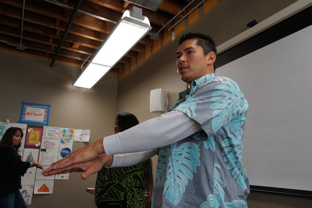 Kaloku Holt teaches hula to the 2016 First Peoples Fund's fellows.
