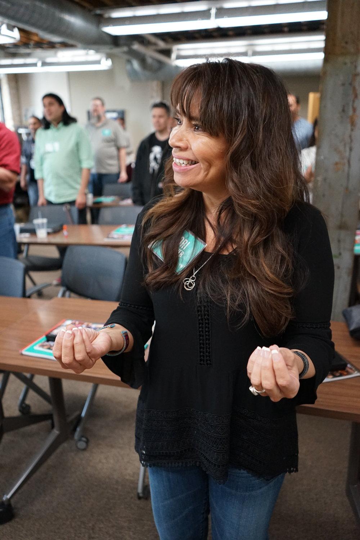 FPF President Lori Pourier picks hula flowers (1).JPG