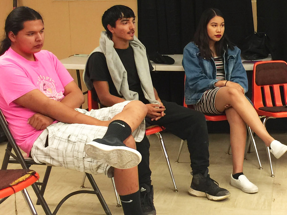 Dorian Baldes (center) shares his thoughts during a Dances With Words Open Mic Night.